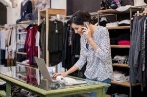 Entrepreneur talking at phone in shop