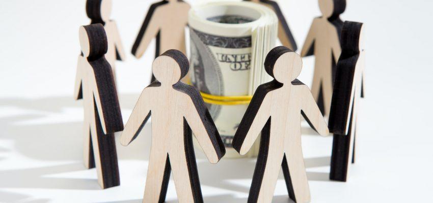 Close up of investors around savings deciding where to invest